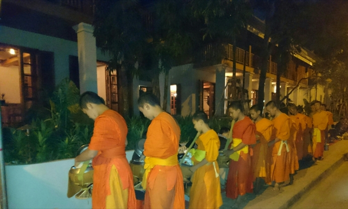Monks collecting alms at sunrise in Luang Prabang