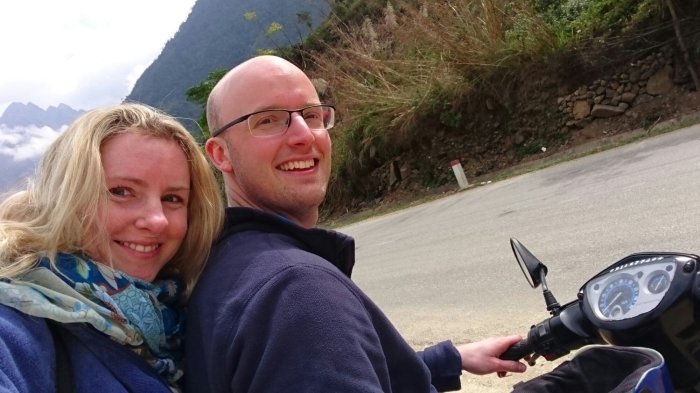 Couple sit on a moped in the mountains of northern Vietnam