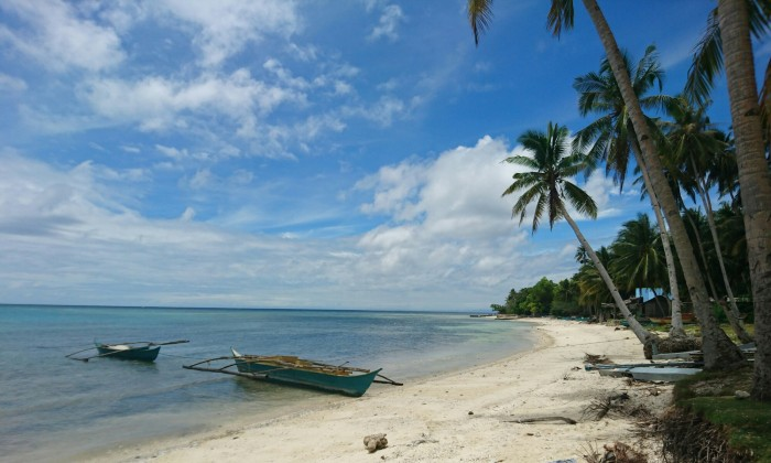 Boats on a deserted beach on Siquijor island, Philippines