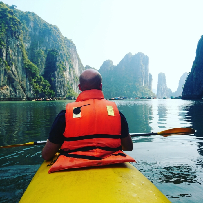 Kayaker in Halong Bay, Vietnam