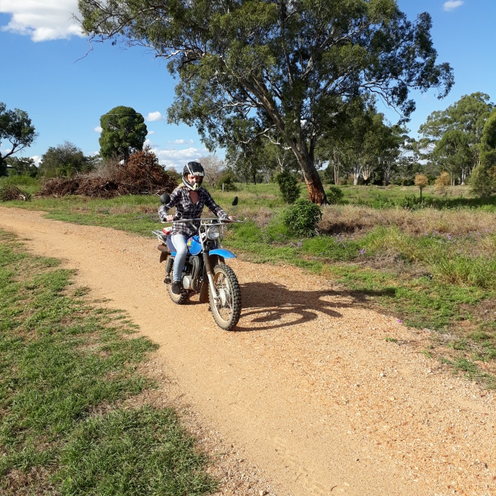 Girl riding motorbike on Myella Farm in Australia