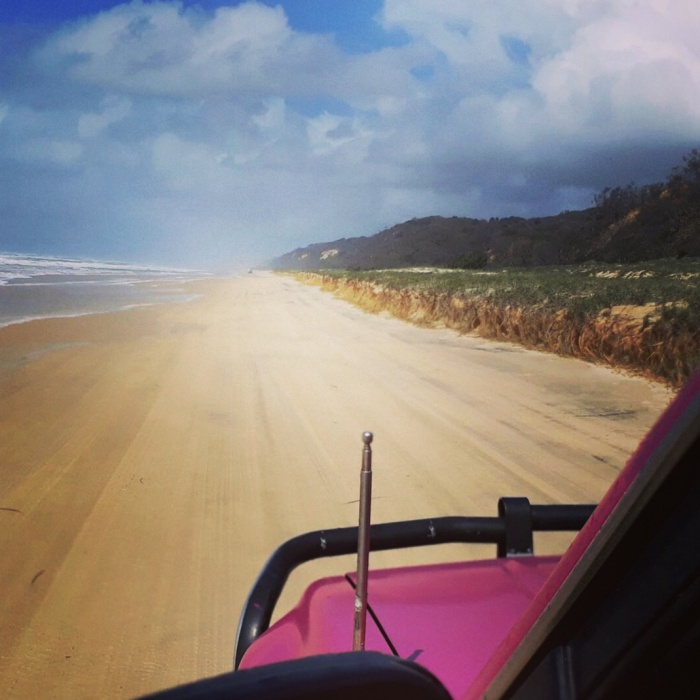 4x4 vehicle driving along Seventy-Five Mile Beach on Fraser Island, Australia