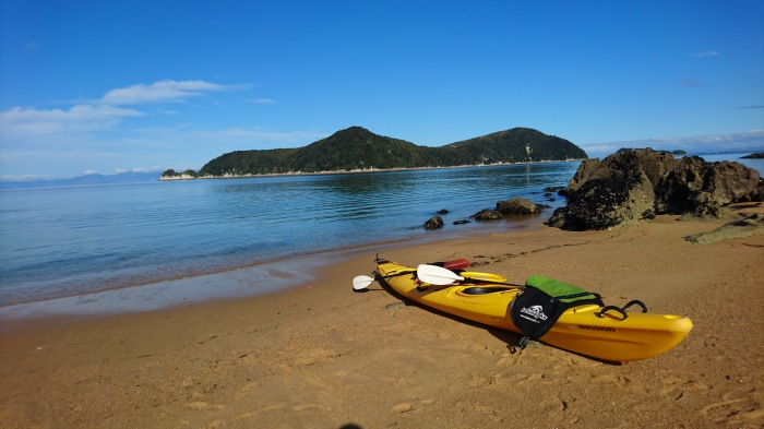Kayak on a beach in Abel Tasman National Park, New Zealand
