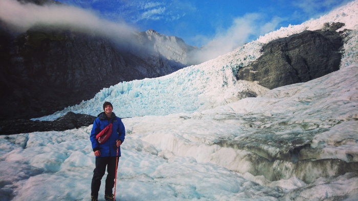 Man hiking on the Franz Josef Glacier in New Zealand