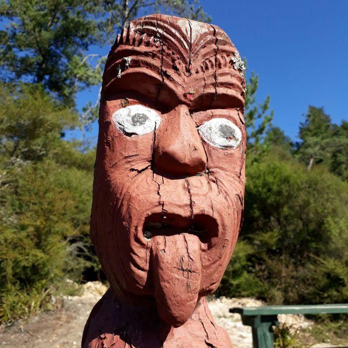 Wooden Maori sculpture in Whakarewarewa Thermal Village
