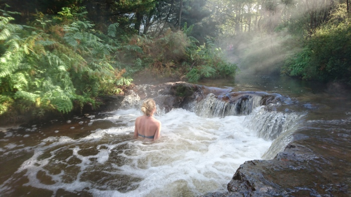 Girl bathes in hotspring in New Zealand
