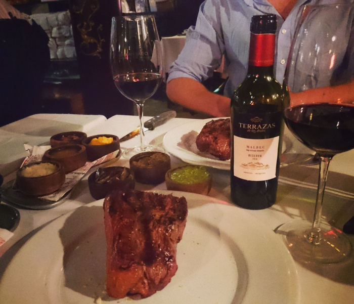 Steak and wine on a restaurant table in Buenos Aires