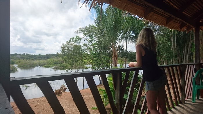 Girl looking out over river from Amazon jungle lodge