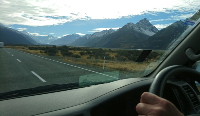 Driving through mountain scenery in New Zealand in a campervan