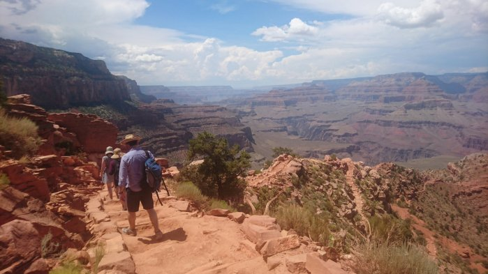 Walkers follow the South Kaibab Trail into the Grand Canyon National Park, USA
