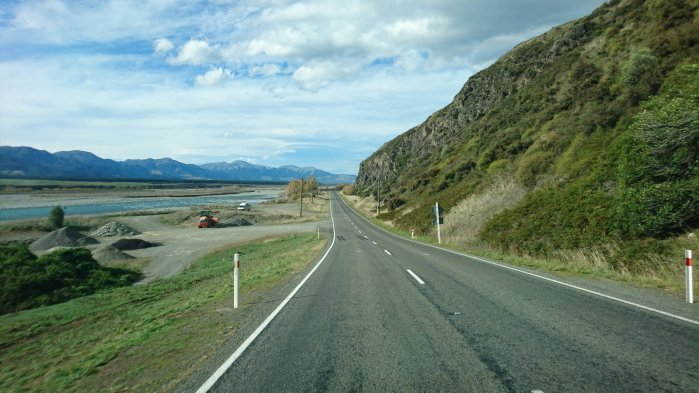 Long road through scenic landscape in New Zealand