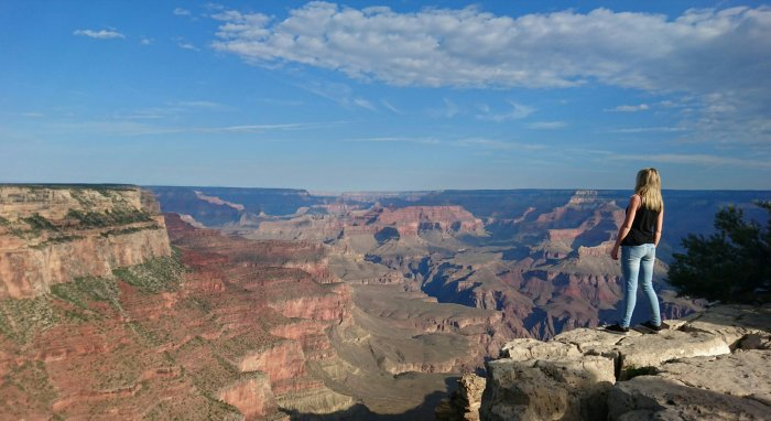 Traveller looking out over the Grand Canyon National Park, USA