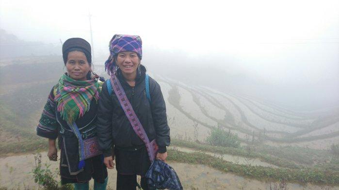 Local Hmong tribeswomen on the misty rice terraces of Sapa, Vietnam
