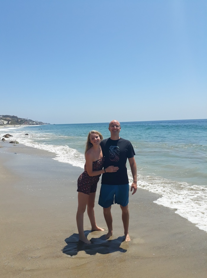 Couple enjoying a day on the beach in Malibu, Los Angeles
