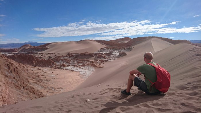 Sitting on top of a sand dune in the Atacama desert, Chile